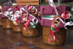 Mason jars filled with homemade orange marmalade decorated for t Royalty Free Stock Photos