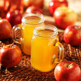 Mason jars filled with hot apple cider Stock Image