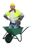 Mason kneeling in wheelbarrow Royalty Free Stock Photo