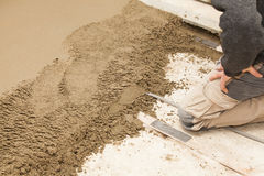 Mason leveling the cement screed Stock Images