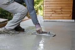 Mason leveling and screeding concrete floor base Royalty Free Stock Photography