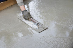 Mason leveling and screeding concrete floor base Stock Photos