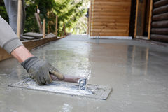 Mason leveling and screeding concrete floor base Royalty Free Stock Photography