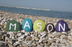 Mason, male name on colourful stones on pebbles Royalty Free Stock Photography
