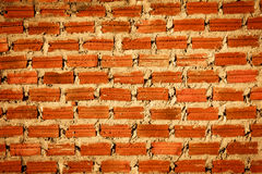 Mason. Orange brick wall that was built beside the temple Stock Photo
