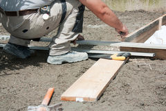 Mason preparing formwork Stock Image