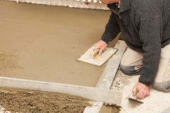 Mason smooth the cement screed Royalty Free Stock Image