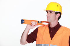Mason with spirit level Royalty Free Stock Images