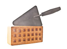 Mason tools. Red brick and trowel, photo on the white background Stock Photo