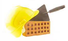 Mason tools. Bricks, trowel and a yellow plastic helmet Royalty Free Stock Images