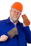 Mason with trowel and brick Stock Photography