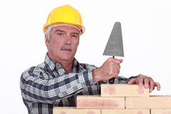 Mason with a trowel. Mason working with a trowel Royalty Free Stock Image