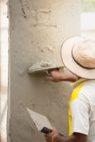 Mason using trowel for plastering the concrete to build wall, Co Royalty Free Stock Photos