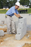 Mason With Concrete Block Royalty Free Stock Image
