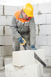 Mason worker bricklayer with hand saw Stock Photo