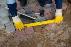 Mason worker making sidewalk pavement Royalty Free Stock Photo