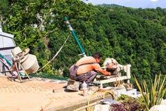 Mason worker tiler making floor Stock Image