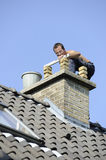 Mason working on a chimney Stock Images