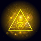 Masonic eye on golden shining background Stock Image