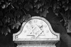 Masonic Symbol In Cemetery. Black and white portrait of masonic symbol on a cross in a cemetery Stock Photography