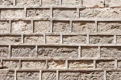 Masonry of an ancient stone wall eroded Stock Photo
