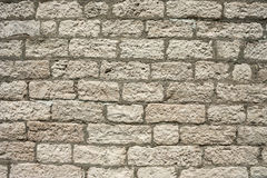 The masonry of an ancient stone wall eroded. Close-up. The masonry of an ancient stone wall eroded Stock Images