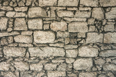 The masonry of an ancient stone wall eroded. Close-up. The masonry of an ancient stone wall eroded Royalty Free Stock Images