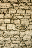 The masonry of an ancient stone wall eroded. Close-up. The masonry of an ancient stone wall eroded Stock Image