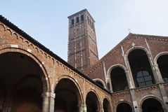 Masonry Basilica. Saint Ambrose church in Milan bell tower and internal facade Stock Images