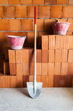 Masonry bricks, Shovel and buckets Stock Photos