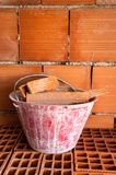 Masonry Bucket on hollow bricks Stock Photography