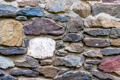 Masonry colored natural stones. Masonry colored natural stone, symbol of texture, background, individuality Royalty Free Stock Image