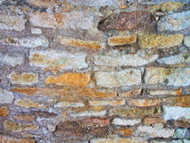Colored stones texture. The masonry of the colored stones on the wall Royalty Free Stock Photos