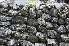 Masonry fence. Fence made of old stone in remote island of Okinawa Royalty Free Stock Photo