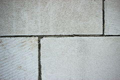 Masonry foam block. Clean the walls of the foam block stock photography