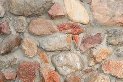 Masonry made of granite boulder. Masonry made of natural granite boulder close-up stock image