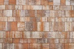 Masonry made of smooth polished stone slabs of sandstone. Texture of a fragment of a wall of an old structure. A background for de stock photos