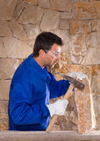 Masonry mason stonecutter man with hammer working Stock Photo