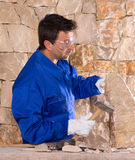 Masonry mason stonecutter man with hammer working Stock Photos
