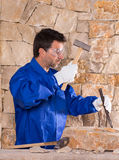 Masonry mason stonecutter man with hammer working Royalty Free Stock Photography