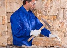 Masonry mason stonecutter man with hammer working Royalty Free Stock Photo