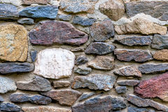Masonry multi-colored natural stones Royalty Free Stock Image