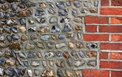 Masonry with red bricks and pebble stones Royalty Free Stock Photos