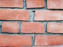 Masonry of reddish-brown color. Brick masonry of reddish-brown color with cement seams Stock Photos