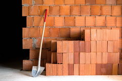Masonry Shovel bucket and bricks Stock Photo