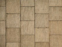 Masonry square wall. Wall with square textured panels royalty free stock photography