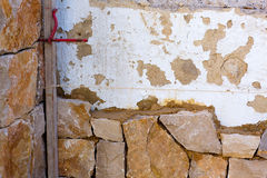 Masonry stone wall construcion process traditional Stock Photos