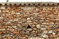 Masonry stone wall triangle windows Formentera Royalty Free Stock Photo
