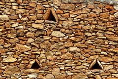 Masonry stone wall triangle windows Formentera Stock Photography