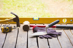 Masonry tool background such as glove and tape measure and sledgehammer with trowel and level and etc.Background craftsman tool. Masonry tool background for home Royalty Free Stock Photography
